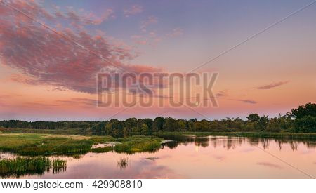 Panorama Of River Landscape In Belarus Or European Part Of Russia In Sunset Time Of Summer Evening.