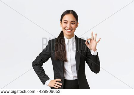 Professional Female Manager In Black Suit Looking Assertive, Encourage Everything Okay, Assure Work