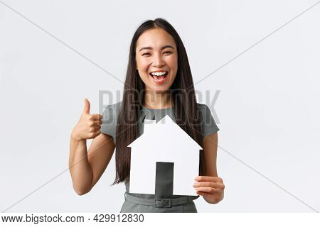 Insurance, Loan, Real Estate And Family Concept. Excited Smiling Asian Woman In Dress, Showing Thumb