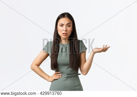 Small Business Owners, Women Entrepreneurs Concept. Confused And Annoyed Asian Businesswoman Waiting
