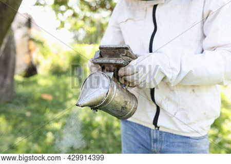Beekeeper Holding Smoker For Smoking Bees Closeup