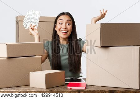 Small Business Owners, Startup And E-commerce Concept. Excited Asian Businesswoman Rejoicing Receivi