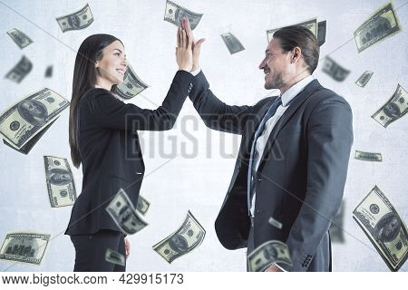 Attractive Young European Businesswoman And Man Hi-fiving Each Other On White Background With Dollar