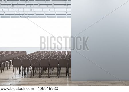 Modern Auditorium Interior With Seating, Wooden Flooring And Empty Mock Up Place On Wall. 3d Renderi