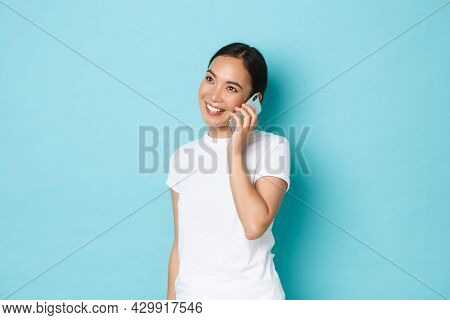 Portrait Of Smiling Modern Asian Girl Looking Happy While Talking On Phone, Confirm Online Order, Ch