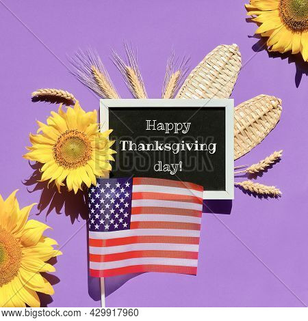 Autumn Thanksgiving Decor With Usa Flag, Sunflowers And Wheat Ears. Text Happy Thanksgiving Day On B