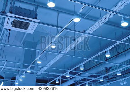Ceiling With Bright Lights In A Modern Warehouse, Shopping Center Building, Office Or Other Commerci