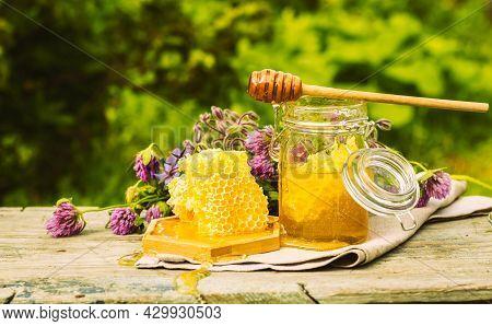 Fresh Honey In A Glass Jar On A Summer Rural Background. Floral Fragrant Sweet Honey Dessert, Front