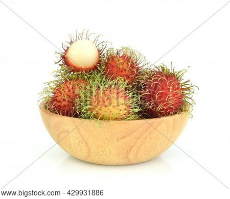 Rambutans In Wooden Blow Isolated On White Background