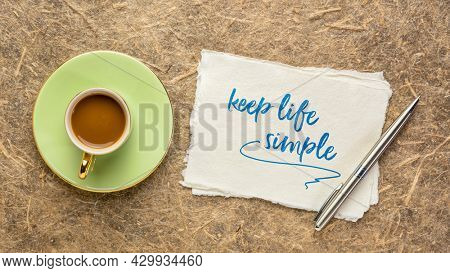 keep life simple  inspirational writing - reminder note on a handmade paper with coffee, simplicity, minimalism and lifestyle concept