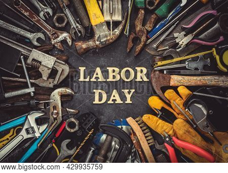 Collection of worn and used work tools with Labor Day text, celebrating American workers.