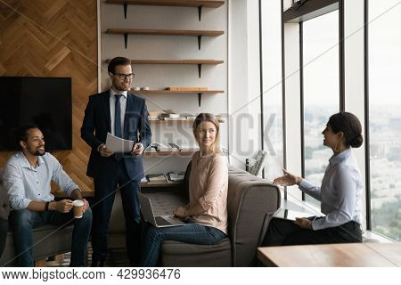 Indian Employee Diverse Colleagues Participate In Briefing Led By Boss