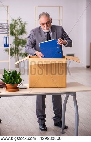 Old male employee in dismissal concept