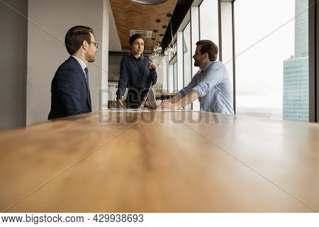 Multi Ethnic Colleagues Brainstorming Together In Modern Office Boardroom