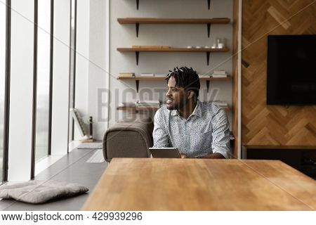 African Guy Hold Tablet Look Aside, Daydreams About Career Growth