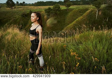 Attractive Slim Sportswoman Posing Outdoors At Daytime Alone