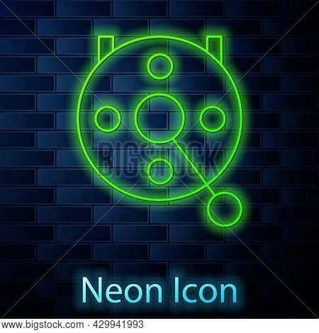 Glowing Neon Line Spinning Reel For Fishing Icon Isolated On Brick Wall Background. Fishing Coil. Fi
