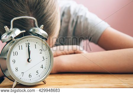 Tired Student With Retro Alarm Clock Preparing For Exams On Bright Light Pink Background With Copy S
