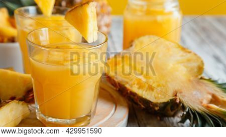 Tasty Pineapple Juice In Glass With Pineapple Fruit Slices. Fresh Natural Pineapple Cocktail And Jui