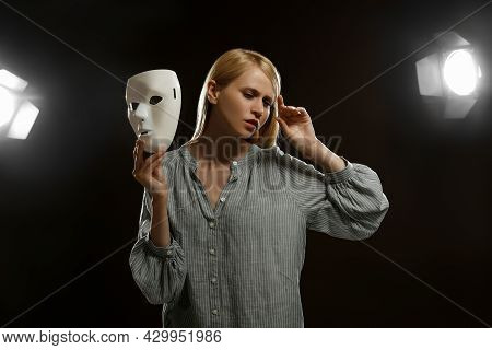 Professional Actress Rehearsing With Mask On Stage In Theatre