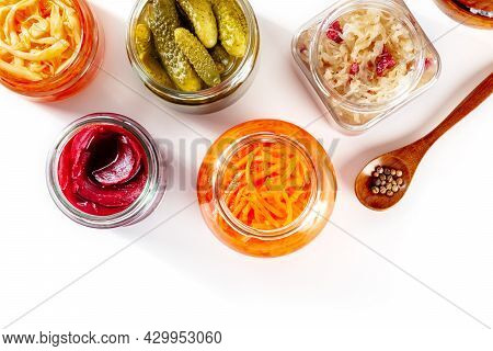 Fermented Food On A White Background With A Place For Text. Canned Sauerkraut, Carrot, Pickles And O