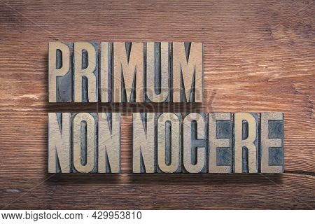Primum Non Nocere Ancient Latin Saying Meaning - First, Do No Harm, Combined On Vintage Varnished Wo