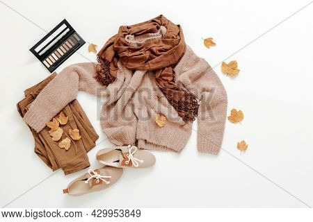 Womens Autumn Stylish Outfit Sweater And Scarf Earth Brown Colour Set On White Background Flat Lay W