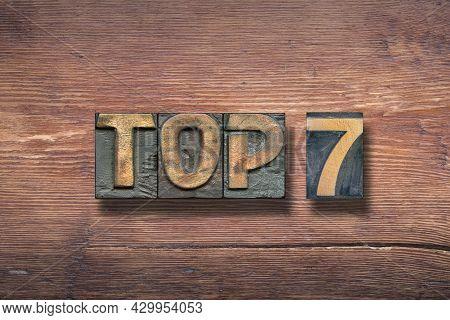 Top 7 Combined On Vintage Varnished Wooden Surface