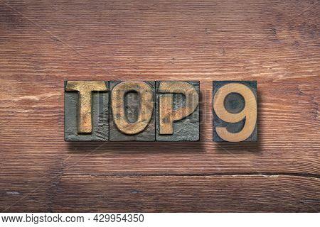 Top Nine Combined On Vintage Varnished Wooden Surface