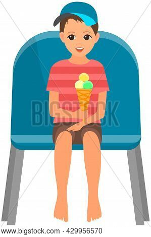 Little Boy With Ice Cream Sitting On Chair And Watching Show Isolated On White Background. Young Mal