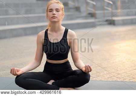 Yoga And Meditation In Modern City Caucasian Woman Relax Lotus Position Sitting Yoga Mat Outdoors Su