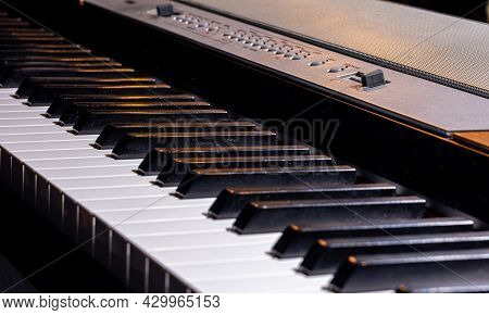 Close-up Of Keys Of A Synthesizer Or Electronic Piano.
