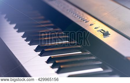 Close-up Of A Synthesizer Or Piano Key In Beautiful Stage Lighting.
