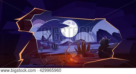 Cave With Bonfire And Night Desert Landscape. Hole In Rock With View Of Cacti And Tree Silhouettes U