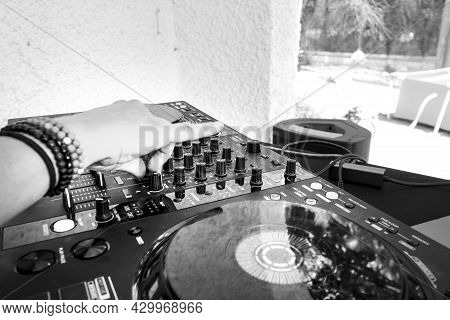 Madrid, Spain- August 14, 2021: Deejay Mixing Music With A Pioneer Dj Music Set In Spain In Summer