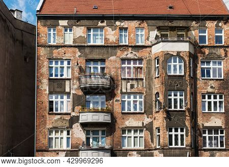 Shabby Cracked Building Facade, Old Windows. Front Facade Of Old Apartment Building In European City
