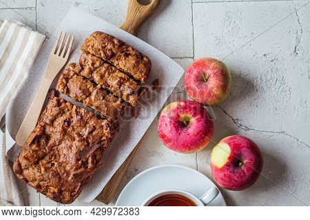 Apple Bread On A Wooden Board. Autumn Fruit Pie, Gray Background, Copy Space, Top View.