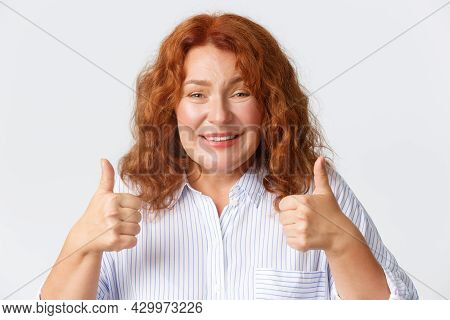 People, Emotions And Lifestyle Concept. Close-up Of Supportive Mother With Red Hair Showing Thumbs-u