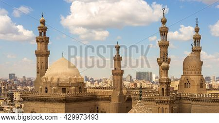 The Minarets And Domes Of Sultan Hassan Mosque And Al Rifai Mosque, Cairo, Egypt On A Cloudy Sky Bac