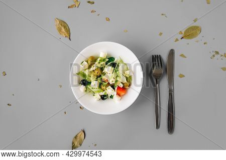 Greek Salad On Gray Background. Top View.