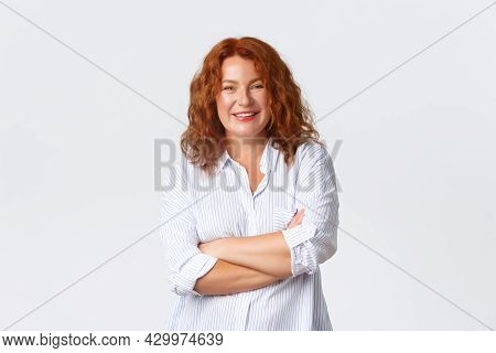 Smiling Upbeat Redhead Middle-aged Woman, Feeling Like Professional, Cross Arms Chest And Looking Co