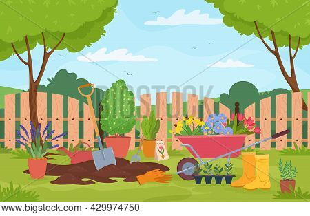 Garden Landscape With Plants, Trees, Fence And Gardening Tools. Wheelbarrow With Flowers, Plant Seed