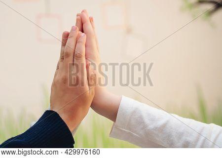 Two Boys Giving High Five. High Five Concept For Success, Teamwork, Congratulating, Celebration. Ele