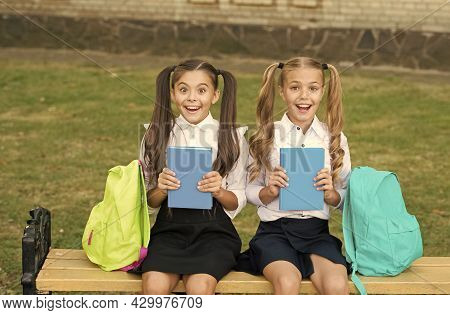 She Has As Many Books As I. Happy Bookworms Outdoors. Little Children Hold School Books. Library Boo