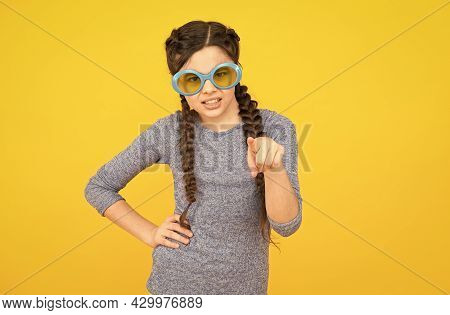 Sunglasses Are Health Necessity. Dissatisfied Kid Yellow Background. Get Party Started. Kid Pointing