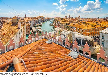 Rialto Bridge Above Grand Canal. View From Rooftop Lookout Terrace Of The Fondaco Dei Tedeschi. Veni