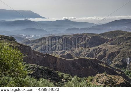 Alpujarra Landscape With Valleys, Ravines, Mountains And A Low Cloud In The Background