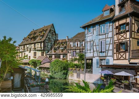 Colmar, Alsace, France July 2021. Petite Venice, Water Canal, And Traditional Half Timbered Houses.