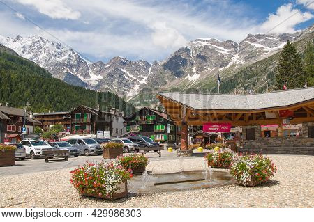 Macugnaga, Italy - July 17, 2021: View Of The Main Square Of Macugnaga Walser Village At The Feet Of