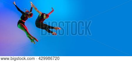 Stylish Sportive Caucasian Couple, Male And Female Dancer Dancing Contemporary Dance On Colorful Gra